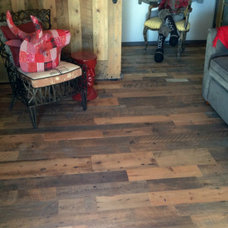 Rustic Family Room by Reclaimed Lumber Products