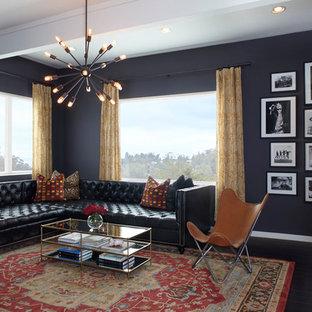 シアトルの大きいトランジショナルスタイルのおしゃれなファミリールーム (青い壁、塗装フローリング、暖炉なし、テレビなし、黒い床) の写真