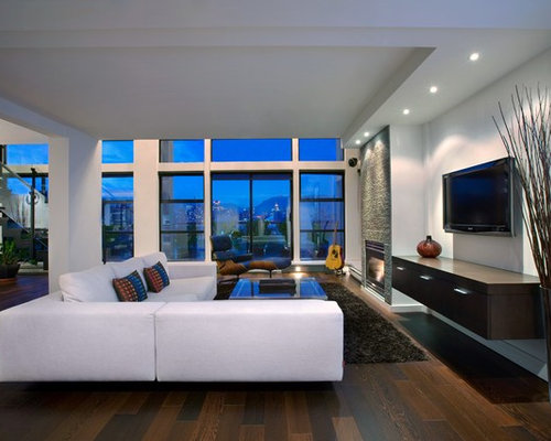 Example Of A Large Minimalist Open Concept Family Room Design In Vancouver With Dark Wood Floors
