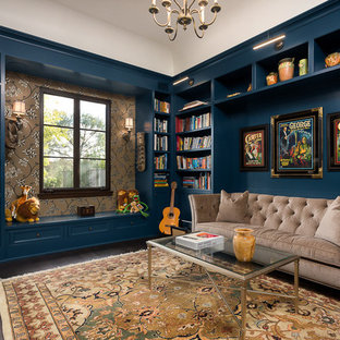 Family room library - mid-sized transitional enclosed dark wood floor and brown floor family room library idea in Los Angeles with blue walls