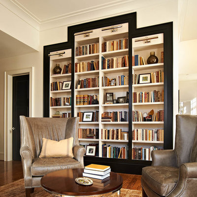 Inspiration for a transitional family room remodel in Raleigh with white walls