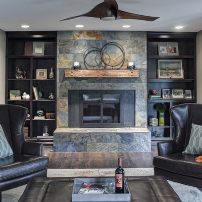 Transitional dark wood floor family room photo in Chicago with gray walls, a standard fireplace and a stone fireplace