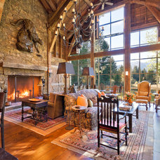 Rustic Family Room by JLF & Associates, Inc.