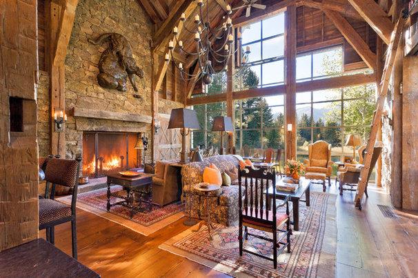 Rustic Family Room by JLF & Associates, Inc.