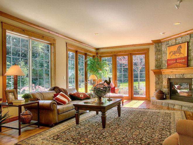 Rustic Family Room by John F Buchan Homes