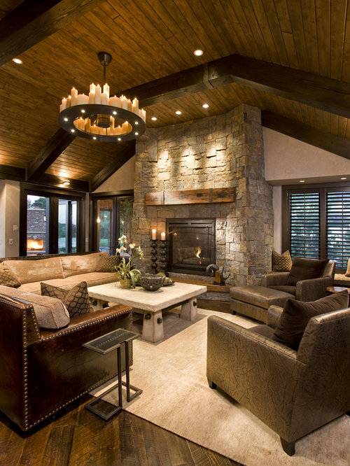 Mountain style family room photo in minneapolis with a stone fireplace