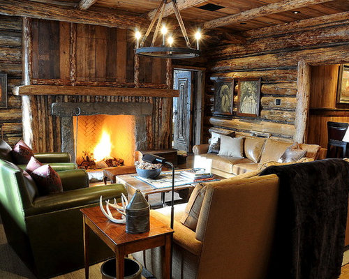 inspiration for a rustic family room remodel in atlanta with a wood fireplace surround