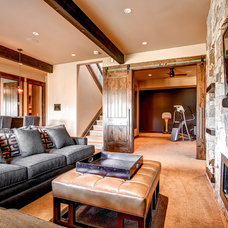 Rustic Family Room by Pinnacle Mountain Homes