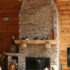 Rustic Family Room by The Quarry Mill Natural Stone Veneer