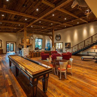 Game room - rustic open concept dark wood floor game room idea in Austin with beige walls
