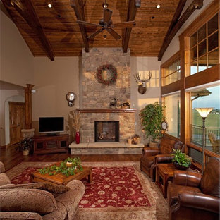 Inspiration for a huge rustic open concept medium tone wood floor family room remodel in New York with beige walls, a standard fireplace, a stone fireplace and a tv stand
