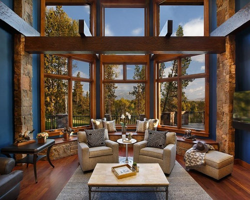 Rustic Home Design. Mountain style medium tone wood floor family room photo in Dallas with blue  walls and a Best 25 Rustic Home Design Ideas Decoration Pictures Houzz