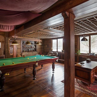 Photo of a rustic family and games room in London.