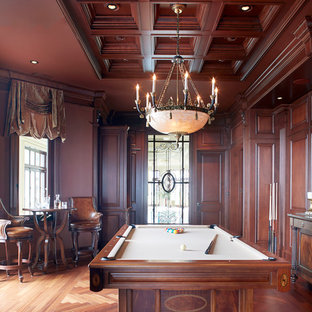 Example of a mid-sized classic dark wood floor game room design in Montreal with brown walls