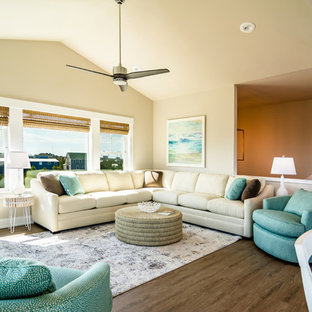 Mid-sized coastal open concept brown floor and medium tone wood floor family room photo in Other with beige walls and no fireplace
