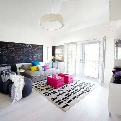 Inspiration for a mid-sized contemporary open concept light wood floor family room remodel in Orange County with white walls and a wall-mounted tv