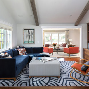 Example of a large 1950s dark wood floor family room design in San Francisco with no fireplace, a media wall and gray walls