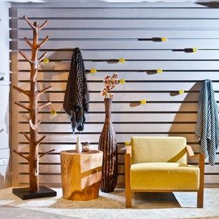 Ejemplo de sala de estar abierta, vintage, pequeña, sin chimenea y televisor, con paredes blancas, suelo de baldosas de cerámica y suelo multicolor