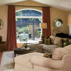 Mediterranean Family Room by M. Roy Interior Design