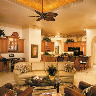 マイアミの広いトラディショナルスタイルのおしゃれなオープンリビング (ベージュの壁、セラミックタイルの床、両方向型暖炉、タイルの暖炉まわり、埋込式メディアウォール) の写真