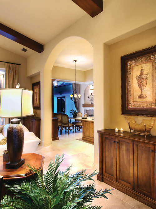 d7f1bb2a03e3c626_4743-w500-h666-b0-p0--mediterranean-family-room Valdivia Home Plan on home of the, home samples, home cargo, home estimates, home blog, home models, home building, home drawings, home contracts, home layout, home planner, home blueprints, home ideas, home kits, home needs, home designing, home floorplans, home tiny house, home home, home problems,