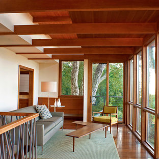 Minimalist medium tone wood floor family room photo in San Francisco with white walls and no fireplace