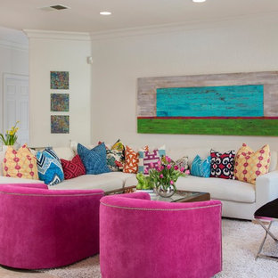 Family room - mid-sized beach style open concept travertine floor and gray floor family room idea in San Diego with white walls, a standard fireplace and a wall-mounted tv