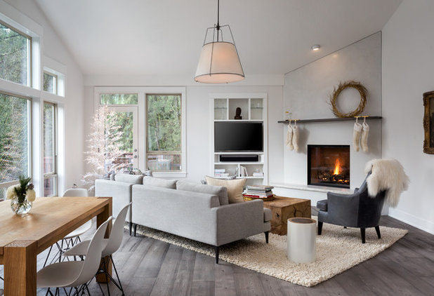 Scandinavian Family Room by Introspecs