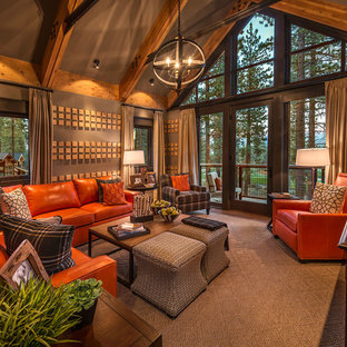 Example of a large mountain style open concept carpeted family room design in Sacramento with brown walls