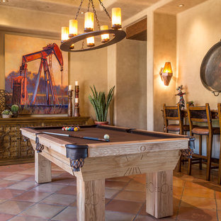 Game room - mid-sized southwestern enclosed terra-cotta floor game room idea in Phoenix with beige walls