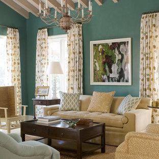ジャクソンビルの大きいビーチスタイルのおしゃれなファミリールーム (緑の壁、濃色無垢フローリング) の写真