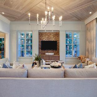 Immagine di un ampio soggiorno classico aperto con parete attrezzata e pareti blu