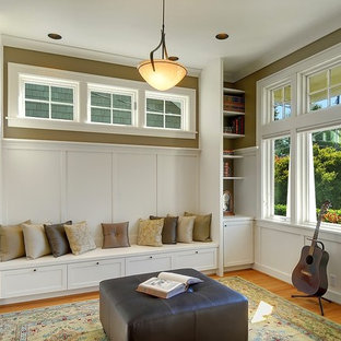 Example of an arts and crafts enclosed medium tone wood floor family room design in Seattle with a music area and beige walls