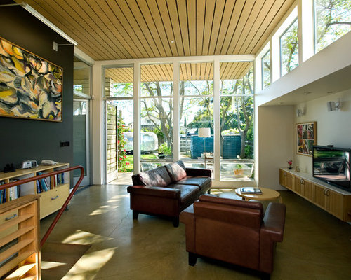 Example Of A Trendy Open Concept Family Room Design In San Francisco With  Black Walls,