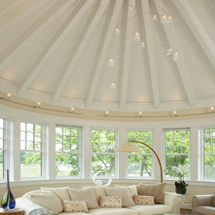 Inspiration for a timeless open concept medium tone wood floor family room remodel in Baltimore with beige walls