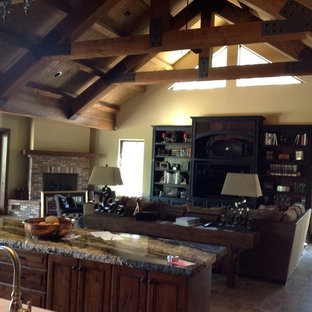 Example of a large arts and crafts open concept family room design in Phoenix with beige walls, a corner fireplace, a brick fireplace and a media wall
