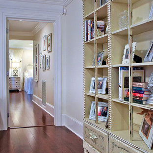 Inspiration for a large shabby-chic style open concept medium tone wood floor and brown floor family room remodel in New Orleans with white walls and no tv