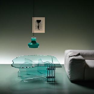 Idee per un grande soggiorno minimalista stile loft con pareti verdi, pavimento in cemento, nessuna TV e pavimento verde