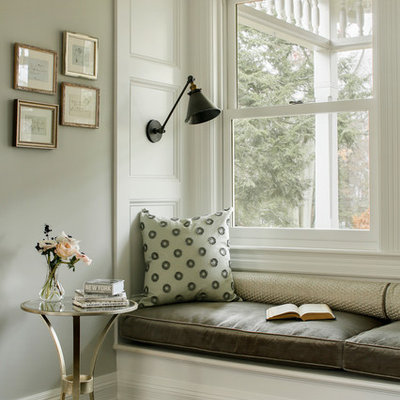 Example of an ornate dark wood floor family room design in Boston with gray walls