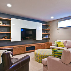 Contemporary Family Room by Sticks and Stones Design Group inc.