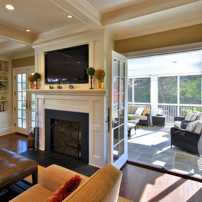 Example of a mid-sized classic enclosed dark wood floor and brown floor family room design in DC Metro with brown walls, a standard fireplace, a media wall and a metal fireplace