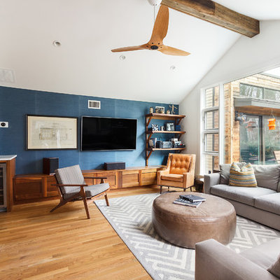 Family room - contemporary open concept medium tone wood floor family room idea in DC Metro with blue walls, no fireplace and a wall-mounted tv