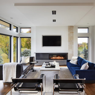 Minimalist open concept dark wood floor family room photo in Minneapolis with white walls, a ribbon fireplace and a wall-mounted tv