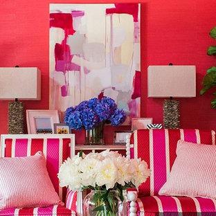 Esempio di un soggiorno eclettico di medie dimensioni e chiuso con TV nascosta e pareti rosa