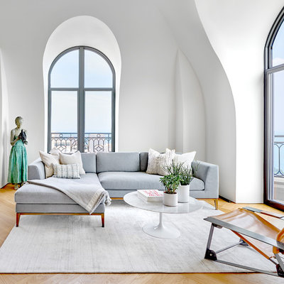 Example of a large trendy open concept light wood floor family room design in Chicago with white walls