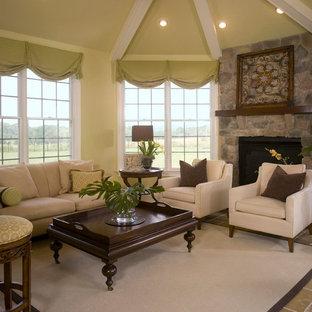Esempio di un soggiorno design con pareti verdi, pavimento in cemento e pavimento beige