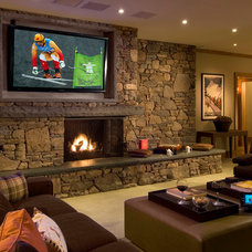Eclectic Family Room by AMBIANCE SYSTEMS