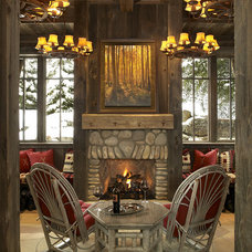 Rustic Family Room by Billy Beson Company