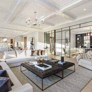 Example of a large trendy open concept light wood floor and beige floor family room design in New York with white walls, a standard fireplace and a stone fireplace