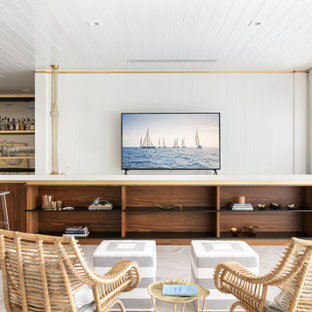 Example of a mid-sized trendy open concept beige floor, shiplap ceiling and shiplap wall family room design in Tampa with a bar, white walls and a tv stand